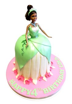 """Princess Tiana Birthday Cake  What a magnificent treat for a little girl of four! We were super excited to create this glorious Princess Tiana cake for an occasion that hosted 15 friends.  The princess is an animated leading character in the Walt Disney movie """"The Princess and the Frog"""". http://cmnycakes.com/gallery2/v/Cakes+For+All+Occasions/Princess+Tiana+Birthday+Cake.html"""