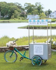 Gillian's sister and maid of honor Laura, a pastry chef, stocked her bike cart with ice cream sandwiches for late-night snacks. The cart featured customized placards in blue and white.