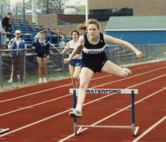 Ledyard High School Track & Field 1990 - Christine Blachuta enroute to a victory in the 300 meter Hurdles (with Coach Douglass and Amy Toth in the Background)