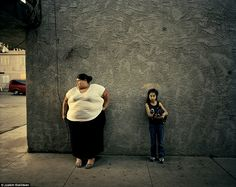 Madai Nunez (left) looks after children like Amy (right) in a migrant worker motel in Fres...
