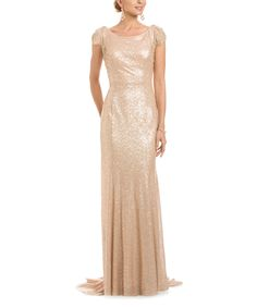 Make a grand entrance in this glamorous dress that showcases a form-flattering cut and an elegant open back. A flowing train ramps up the drama on this stunning look.Size 8: 62'' long from high point of shoulder to hem100% polyesterDry cleanImported
