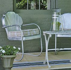 A bright metallic spray paint makes these metal chairs pop on a front porch. New seat cushions (bought to match the paint color), finish the look.