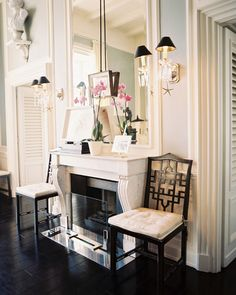 homes with crown molding and paneled walls so if I were custom building or remodeling my own home, I would add all of that detail and charm of elegant, traditional homes. I'd go for dark wood floors, subtle tonal walls, and lots of built-in shelving.