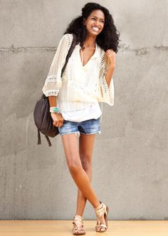 These jean shorts are worn with a light, airy top. the outfit looks cute and effortless at the same time.
