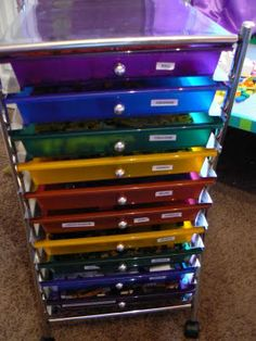Scrapbook paper drawer tower used for LEGO organizing.   The Creative Homemaker