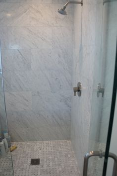 Gorgeous Carrara marble shower in this beautiful bathroom