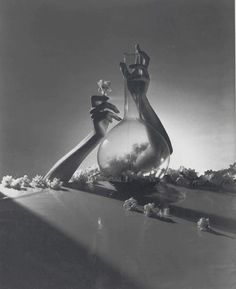 What a beautiful image.  Horst P Horst | Lisa, Hands with Vase and Flowers / 1941