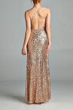 Shimmer with elegance in this gold sequined criss cross open back cocktail dress. Features Criss Cross Straps V-Cut Neckline Back Closure Sequined design Occasion Prom Cocktail