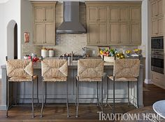 Woven rush stools are generously sized for comfort and bring interesting texture and a California rustic aesthetic to the space. - Photo: John Merkl / Design: Catherine and Justine Macfee
