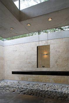 #bathroom #minimal #stone walls #pebble floor #floating sink - casa-uro