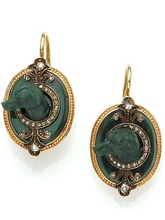 <the Earrings> A set of antique bloodstone and diamond jewelry, circa 1860 the oval-shaped bloodstone brooch-pendant within a surround of gold, centering a dog's head within a circle and double fluer-de-lys of rose-cut diamonds, suspending a vinaigrette; a pair of earrings en suite; mounted in fourteen karat gold.