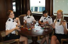 """Yacht stewardesses on M/Y """"Big Aron"""" taking a break on board. Photo by Suki Finnerty of YachtingToday.TV (taken circa 2011). Learn more about interior-crew training to work #belowdeck on a superyacht here: http://www.workonayacht.com/index.php/yacht-stewardess-training-interior-crew/"""