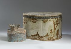 THREE PAPER-COVERED BOXES INCLUDING A LARGE BOX WITH SQUIRRELS, A SMALL OVAL BOX AND AN OPEN BASKET WITH SCALLOPED RIM.
