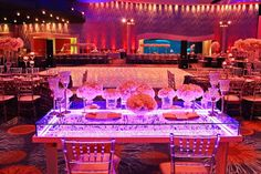 Gorgeous view from Jared and Lana Cook's bling and lit sweetheart table at their Georgia Aquarium wedding. Wedding Planned & Design by Tiffany Cook Events.