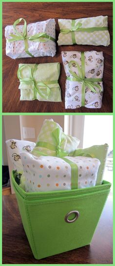 I tried to be creative with a baby shower gift.  I got a few small things from the registry and a four-pack of receiving blankets.  I wrapped each item in one of the blankets and finished off with some satin ribbon.  Instead of using a box, I grabbed a pair of storage bins that match the nursery decor.