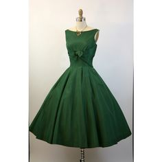 Vintage 1950's emerald dress with front detail. Very graceful.