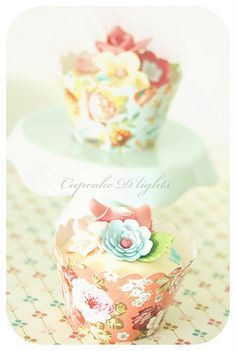 like the pretty cupcake papers - bet you could use pretty wrapping paper if you figured out a pattern:)