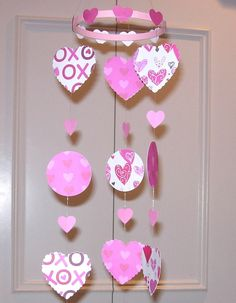 Would be cute hanging from a light fixture or just about anywhere. Looks like all you would need is some Valentines card stock paper.