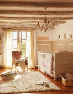 Roses and Rust: Rustic Elegance. Beautiful baby girl nursery in a historic 300 year old home in northern Spain. Warm, light-filled, and inviting.