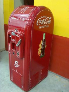 Vintage Coke machine. I guess I'm old because I can remember having to push that lever down to get the bottle to fall into the slot after you put your money in. This was while it still cost a nickel for a bottle of the cold beverage, too.