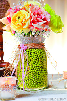 Fill a clear vase with foam beads and gemstones (we chose a pop of bright green) for an easy, but beautiful, floral arrangement.