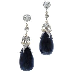 Belle Epoque Natural Sapphire and Diamond Pearl Dangle Earrings. World class one of a kind Grand Epoque dangle earrings with old European cut diamond tops, natural pearl and diamond drops and incredible natural GIA certified natural no heat deep Royal blue Sapphire bottoms.  Platinum, c 1880