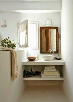 Un ba o de microcemento y toallas en rosa microcemento for Reformar bano economico