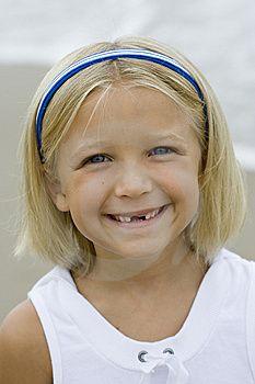 sweet smile inspite of missing teeth .