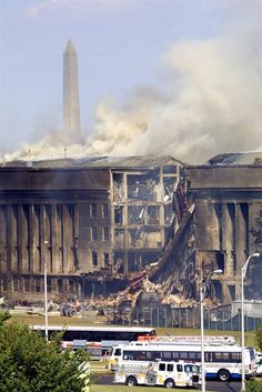 Smoke billows from the Southwest E-ring of the Pentagon building Sept.11, 2001, in Arlington, Va., after it was hit by hijacked American Air...