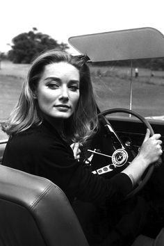 "British model and actress Tania Mallet as ""Tilly Masterson"" at the wheel of a Ford Mustang in a production still from GOLDFINGER (1964)"