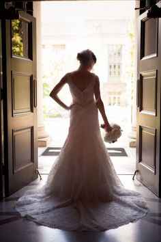 Backlit photo of bride standing in the doors of the church!  Stunning!