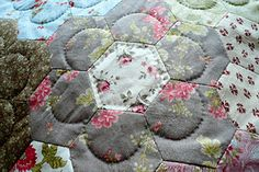 Cute idea to quilt hexies.  And it's HAND stitched, too!!  - new ideas are so great, this looks wonderful