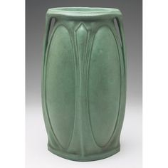 "Teco Pottery (1899-1917) - Two-Handled ""Cameo"" Vase, Number 301. Matte Green Glazed Pottery. Design Attributed to Fritz Albert. Chicago, Illinois.13-1/2"" x 8""."