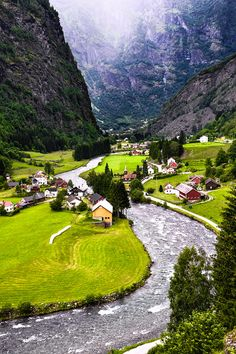 Flam, Norway, at head of the Aurlandsfjord, a tributary of the 204 kilometres long and up to 1308 metres deep Sognefjord. Surrounded by steep mountains, roaring waterfalls and deep valleys, Flåm is a paradise. (I spent three nights here in '84.)