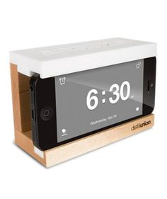 Just because your iPhone is your go-to alarm doesn't mean you have to forgo a formal spot on your nightstand. Before bed, simply slip your phone inside this sleek dock and it's transformed into a traditional-looking clock with a big snooze button. Bonus: The dock helps corral and conceal charging cords.