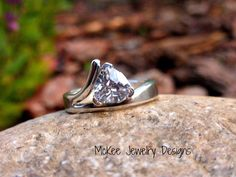 Sterling silver with Trillion cut CZ diamond like stone ring. Thick metal band. McKee Jewelry Designs