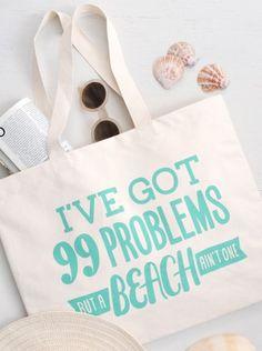 'I've got 99 problems but a beach ain't one', a fantastic new tongue-in-cheek canvas beach bag from Alphabet Bags.