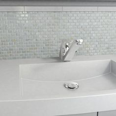 Brighten up your kitchen decor with this white mosaic tile from SomerTile. Crafted out of natural shell pieces to give the room an iridescent feel, this elegant tile resists water absorption, making it the perfection solution for indoor and outdoor use.
