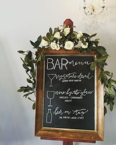 Guests will be delighted to see a beautiful bar menu created with calligraphy in chalk on a chalkboard in a frame. What an elegant statement for a country or city wedding. Repin to remember this idea!