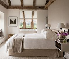 A Lynn Geesaman photograph is displayed in the master bedroom; the nightstand is by BDDW, and the rug is by Edward Fields.