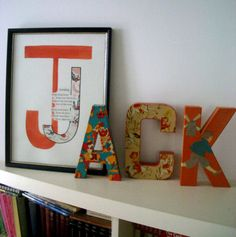 Painted letters and scrapbook paper, smart.