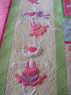 S-W-E-E-T quilt!  The quilting amplifies the darling applique perfectly!  <3 <3 <3  I think the pattern is by Amy Bradley Designs and machine quilted by Raylene Smith.