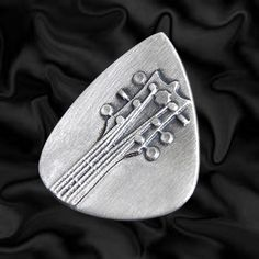 Embossed Head Stock Silver Plectrum | Embossed Silver Guitar Plectrums | Precious Plectrums