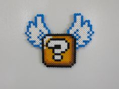 Super Mario World flying item block magnet. $4.99, via Etsy.