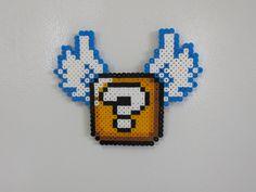 Super Mario World flying item block magnet. $4.99, via Etsy.