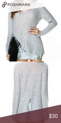 "BB Dakota Twink Sequin Sweater from Nasty Gal Awesome gray tee featuring a slight Sequin detailing and slit at back✨Long, loose fit✨Cut slightly longer at back✨50% Acrylic 35% Nylon 15% Mohair✨ 36"" Bust 24"" Length (measurements taken from size small)✨Used once, in excellent like new condition✨Pet free and smoke free home💝 Tops Tees - Long Sleeve"