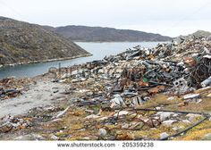 Waste disposal site in Aasiaat, Greenland with old pipes