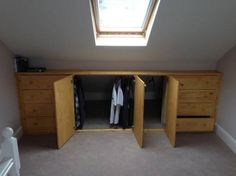 nice storage under sloped roof . Ikea hack using tarva drawer-cabinets http://www.ikeahackers.net/2014/07/under-eaves-storage-tarva-hack.html