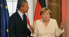 German Chancellor Angela Merkel gestures next to US President Barack Obama
