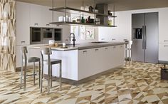 """A dynamic space for the family gatherings where these interior design coverings with their array of neutral tones enhance the brightness of this kitchen. Our """"piano"""" luxury marble tiles in the """"chantilly"""" palette from the """"Opus"""" collection, here in the polished finish."""